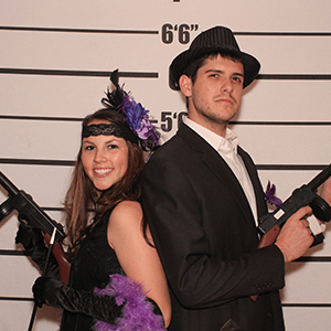 Billings Murder Mystery party guests pose for mugshots
